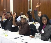 Civil society representatives from Zimbabwe including Jacob Mapfume (center) are regular participants in SALO's policy dialogue events.
